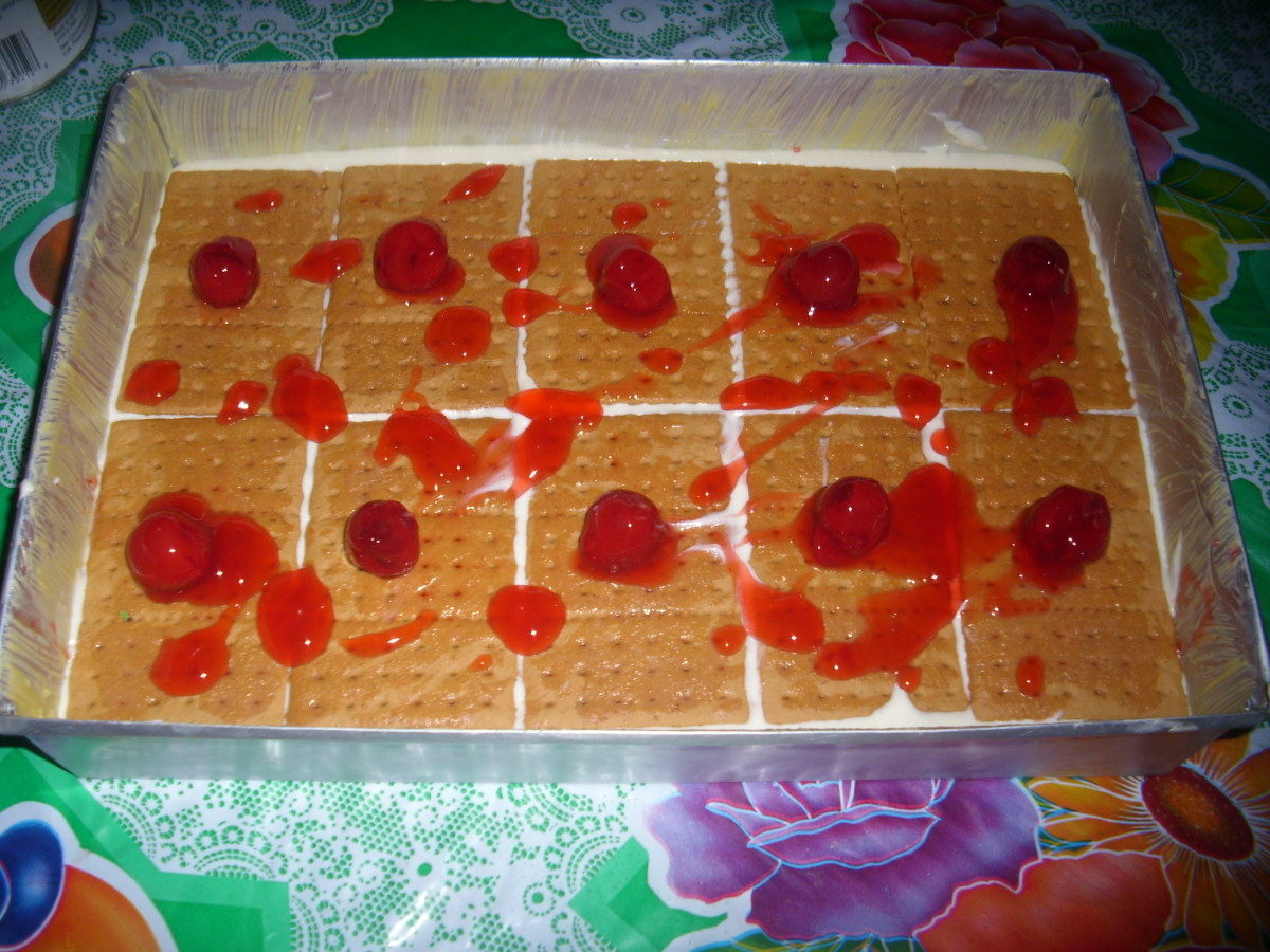Second layer: Graham Crackers brushed with cherry liqour and added cherry fillings.