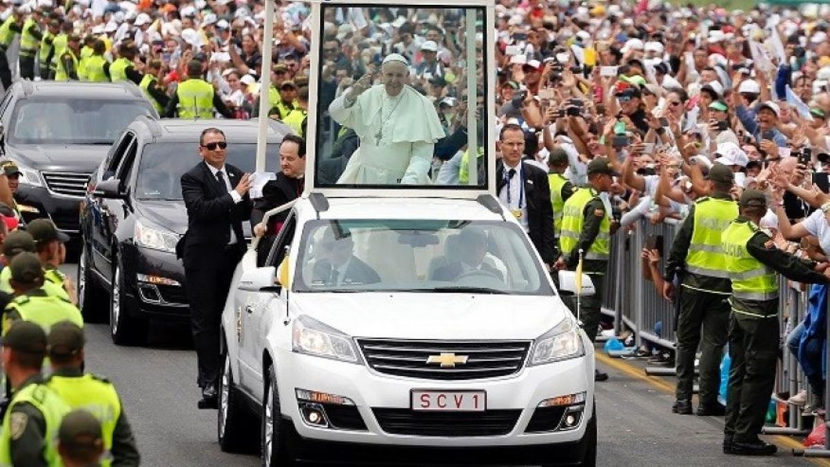 Wherever the pope goes, there are big crowds that want to see him, after all he is the leader of the Roman Catholic church, so, he makes sure that he meets his follower the best way he can, one of his ways is to greet them from his pope-mibile