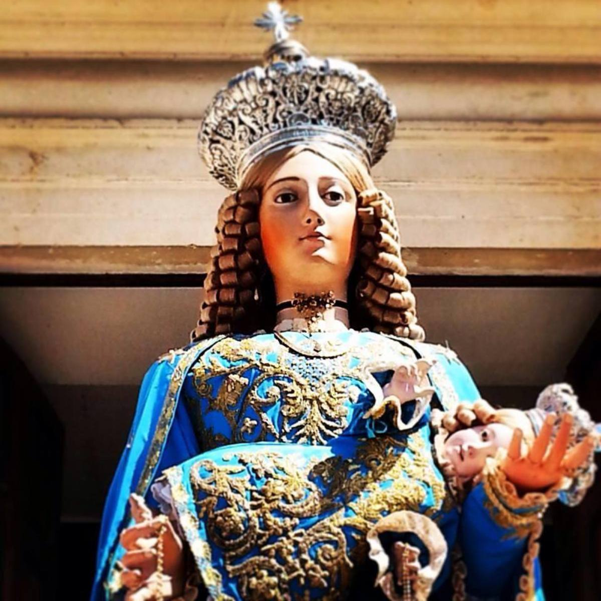 This statue of the Madonna is a beautiful statue that replace the real icon of Maria Santtissima delle Grazie. You see the real icon Madonna is a relic that is kept in the church wall high above the high alter, it is rare that this icon is taken out.