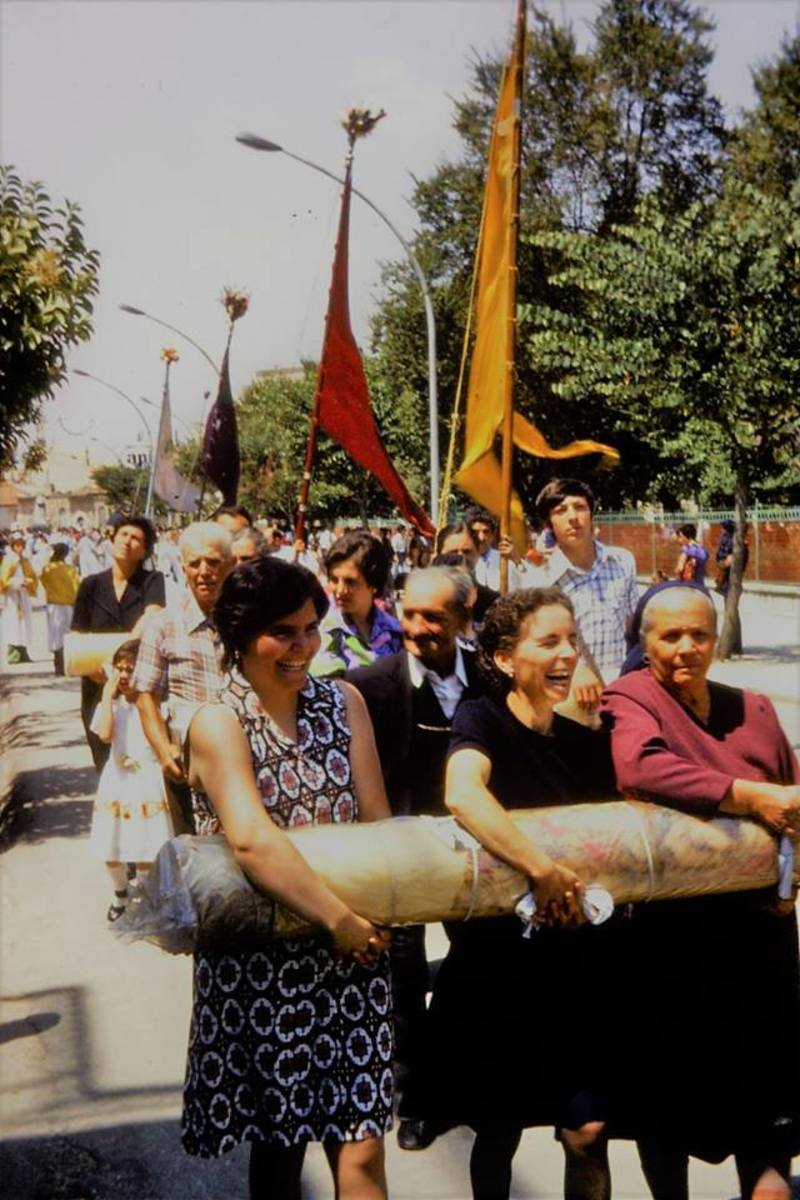 Devotees of this Madonna, at this Madonna feast sometime buy this large candela, then they walk in the procession holding this large weight in their arms for hours. So, they give money and work hard, because they believe this Madonna could help them