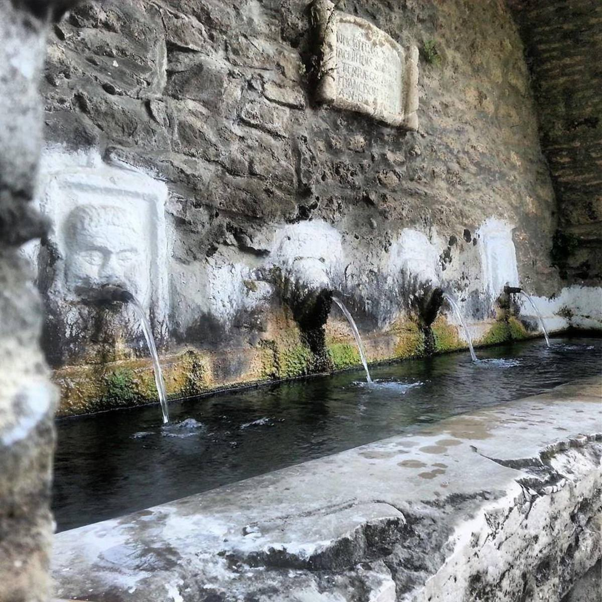 One of the two troughs with four spouts at the old fountain of Capo Daqua. For anyone interested in seeing how people used to build with rubble stones in the past, here is a good example, of course you can also see some repairs done lately.