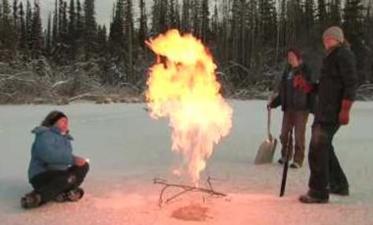 Dr. Katey Anthony flares a methane seep in an Alaskan lake.  Dr. Anthony has identified over 100,000 methane sources.  Image captured from Youtube video.