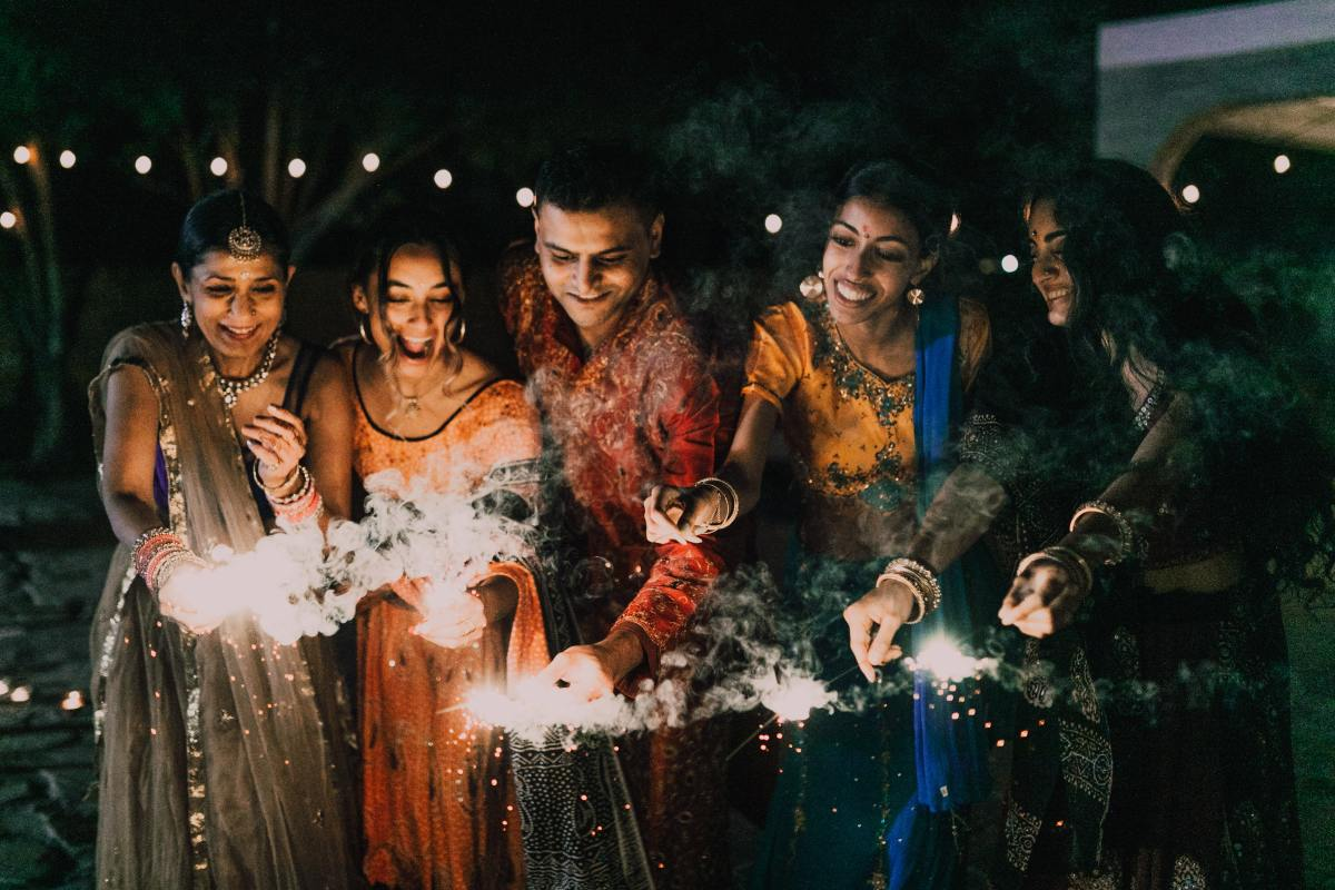 People celebrating Diwali with firecrackers