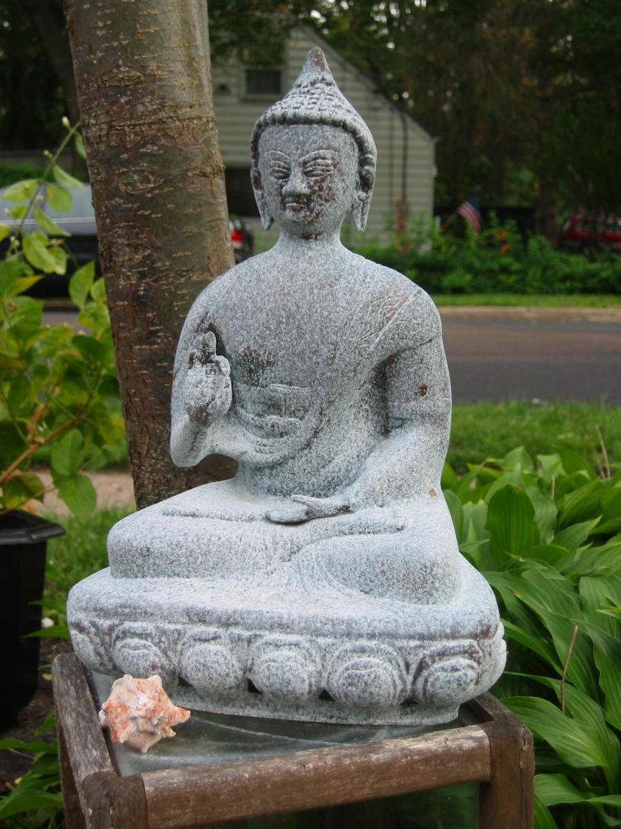 Classic yoga pose of a Buddha statue..