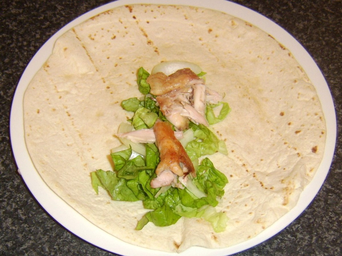 Salad and chicken meat laid on wrap