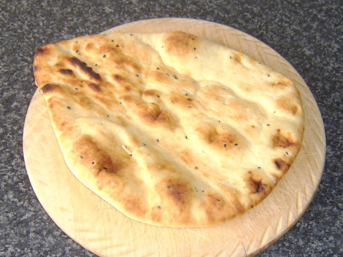 Naan bread ready to be sliced and served