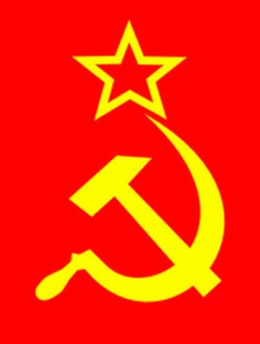 Current Flag. Hammer and hook=workers and peasants. Star=Communist/Socialist party dominiation.