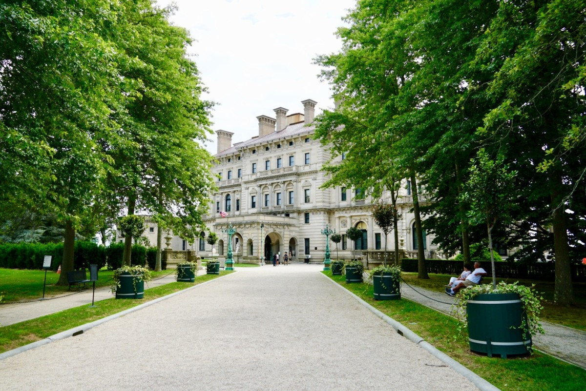 The gravel driveway leading to the front entrance of The Breakers