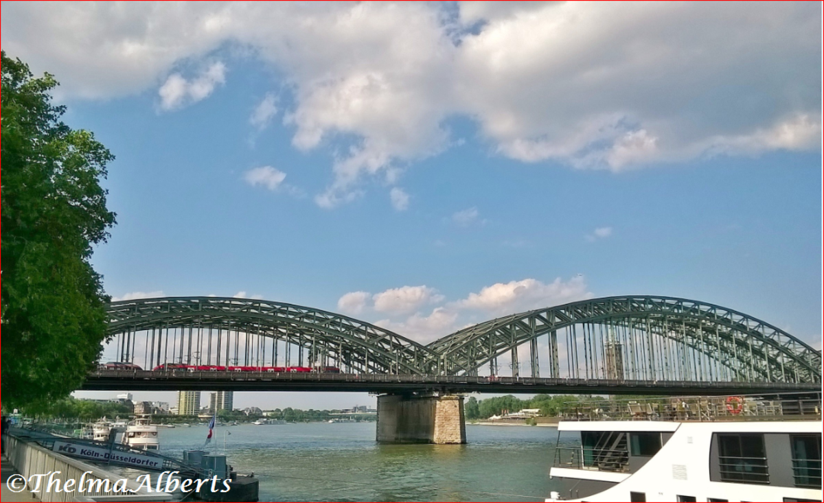 Cologne at the Rhine with the view of the Hohenzollern Bridge, Germany.