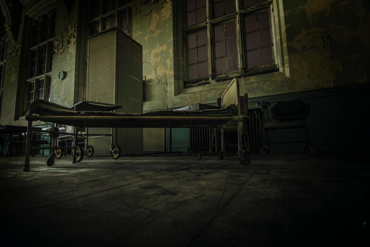 A photo of an abandoned asylum which symbolizes the album's cover in a way.