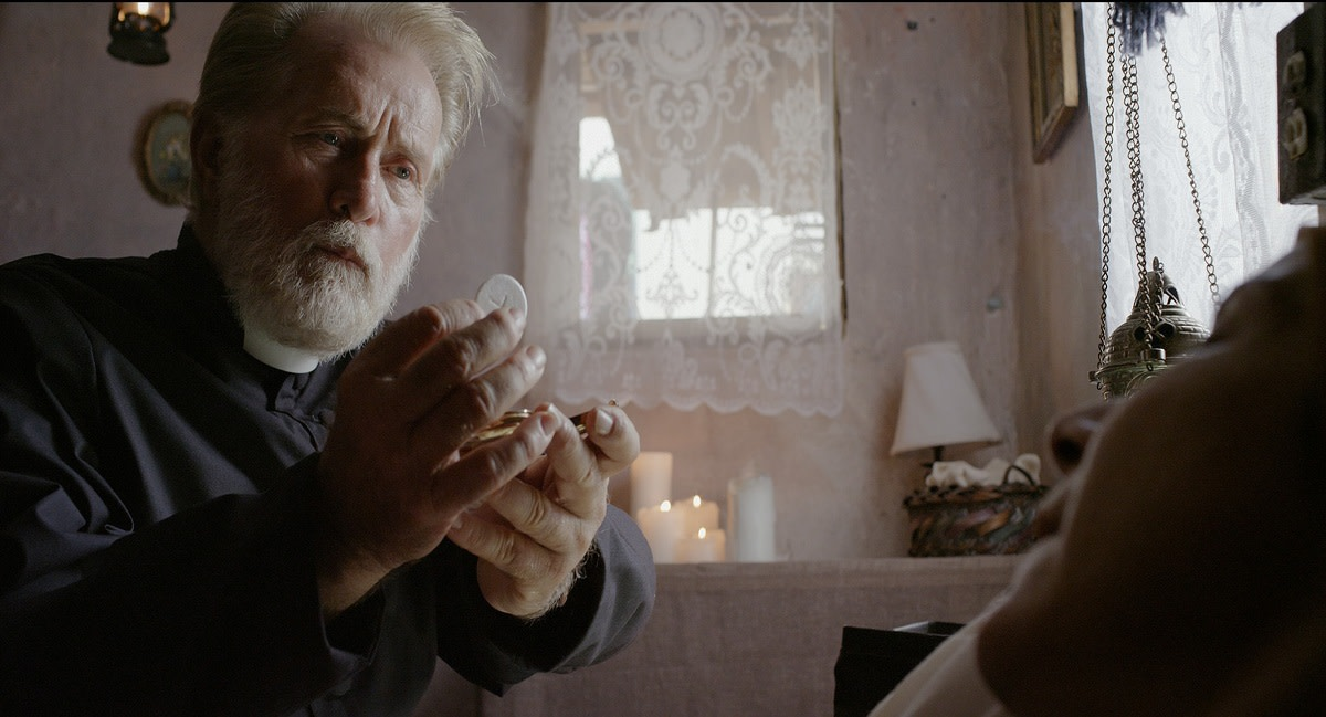 "Martin Sheen as Father Douglas in ""The Vessel."""