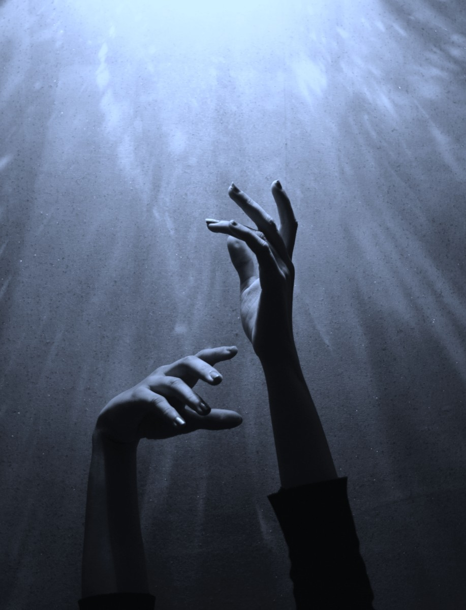 Hands reach high to the heavens to catch a falling star.