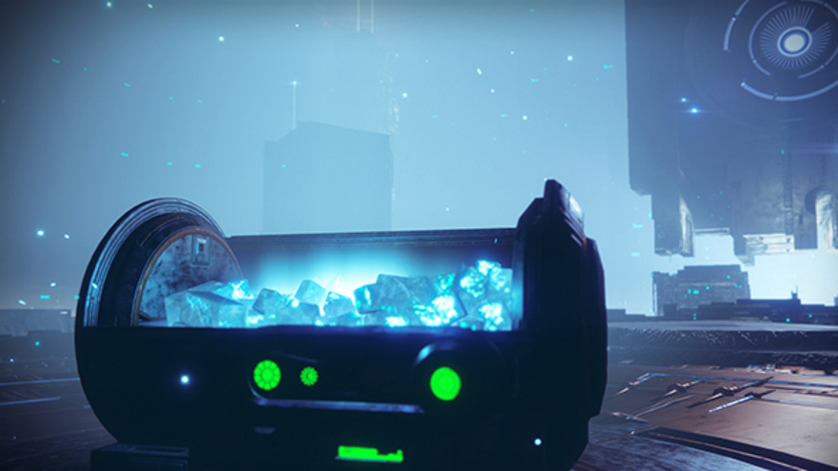 A chest filled with glowing blue cubes known as glimmer.