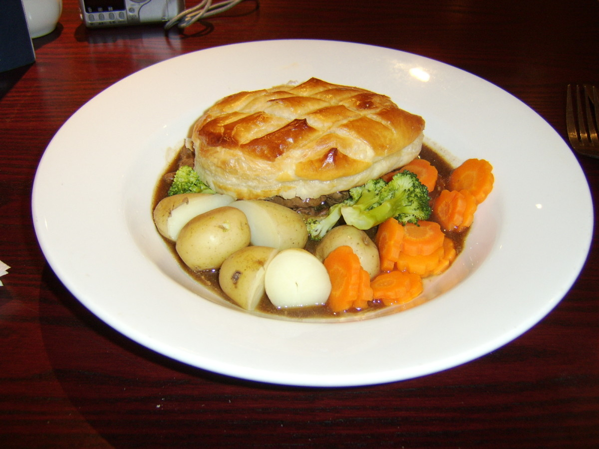 Steak and ale pie is just one of the many types of pies you may find served as British pub grub