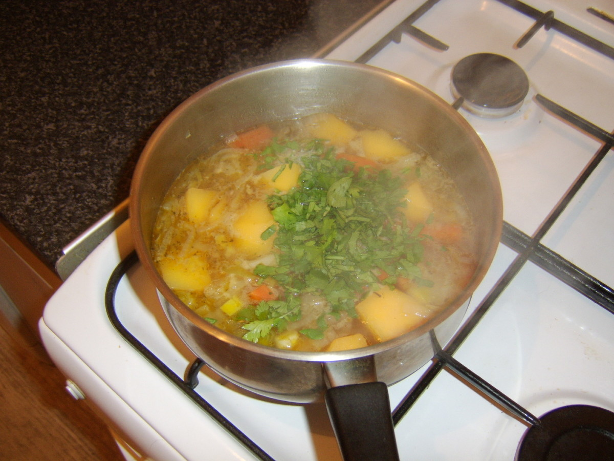 Chopped coriander is added to the vegetable stew before service