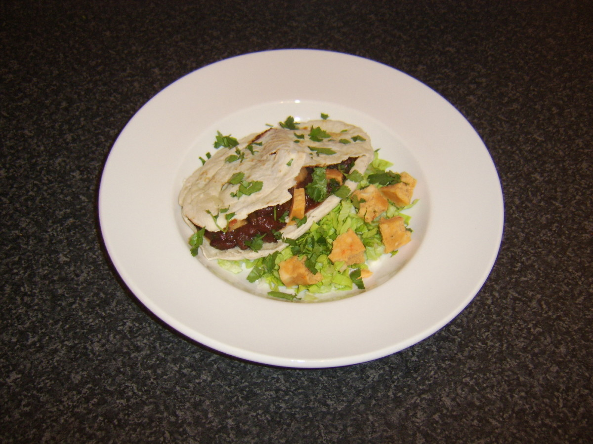 Chilli made with real beef is stuffed in to a pitta bread and served with Mexicana cheese salad