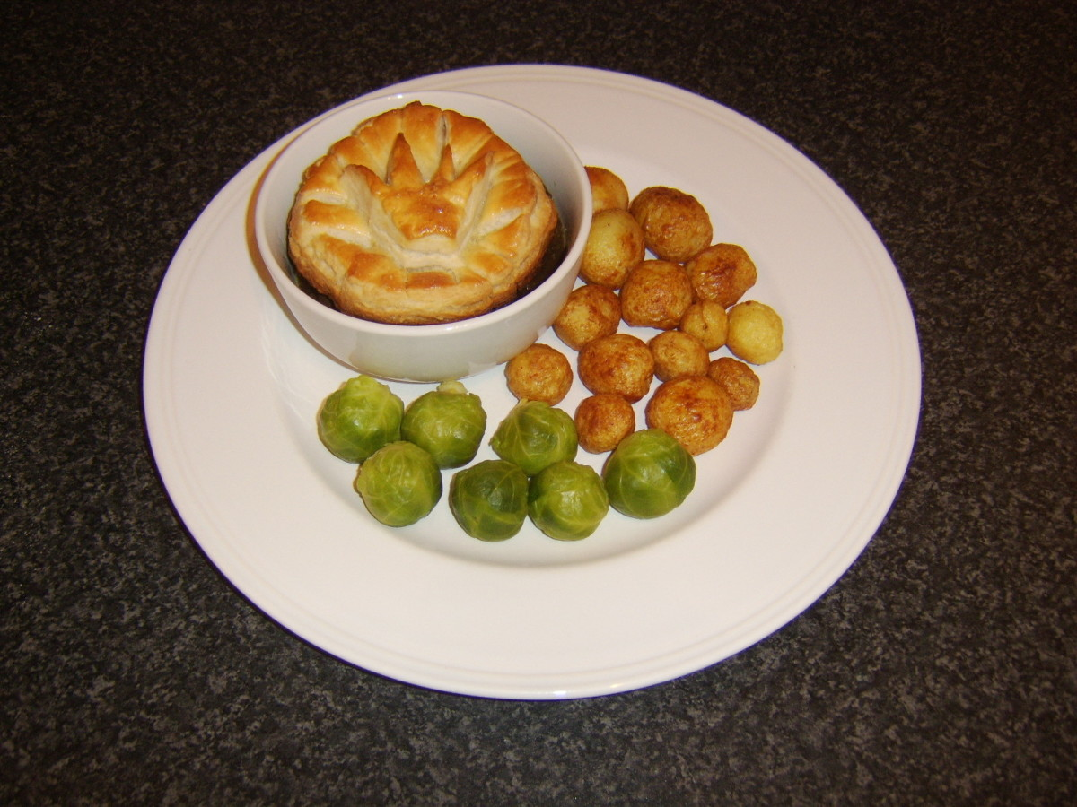 Slowly braised Scottish venison topped with puff pastry and served with roast potatoes and Brussels sprouts
