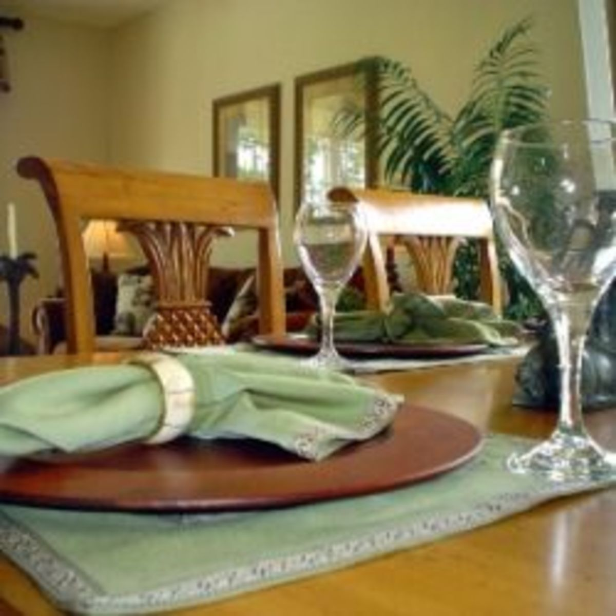 The formal look of polished wood, celadon green placemats, a gracious living mark this look as truly Southern but with a soft and easy look that came from those sweet Gulf breezes.