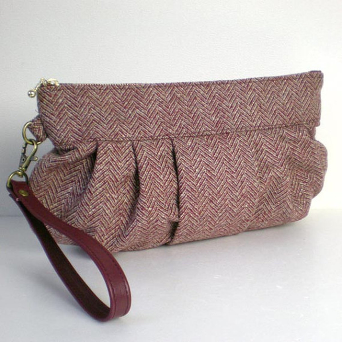 Herringbone Tweed Wool Wristlet Clutch bag with a leather strap, purple brown