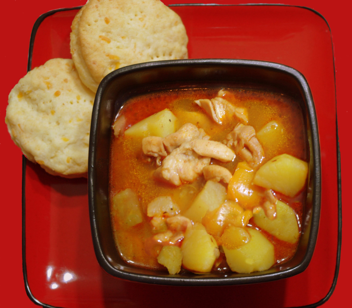 Homemade chicken stew with cheese biscuits