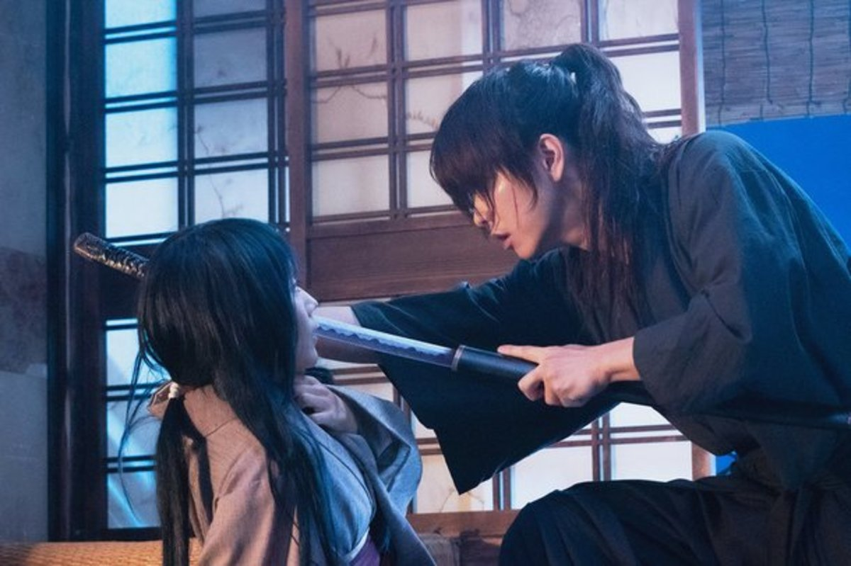 Courtesy of Netflix and Warner Bros. Kenshin nearly kills Tomoe after disturbing his rest after a battle during the Boshin War. Both people were chronologically in their mid to late teens.