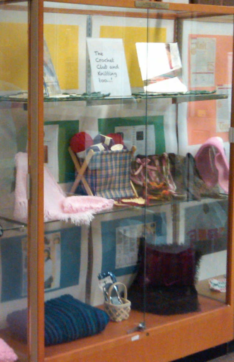 Display of knit and crochet items by club members where meetings are held