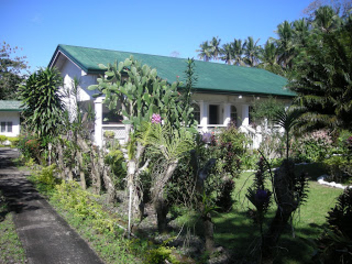 This is the front yard of the main House built in 1998. The front is the national road and at the back is the beach.