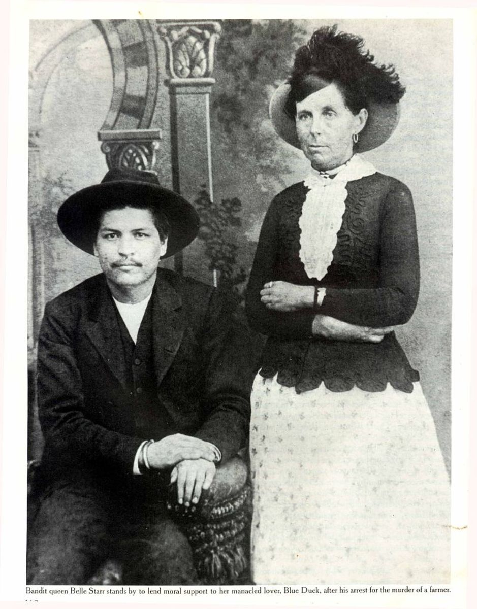 Belle photographed in 1886 with Oklahoma outlaw Blue Duck with whom she may have had an affair.