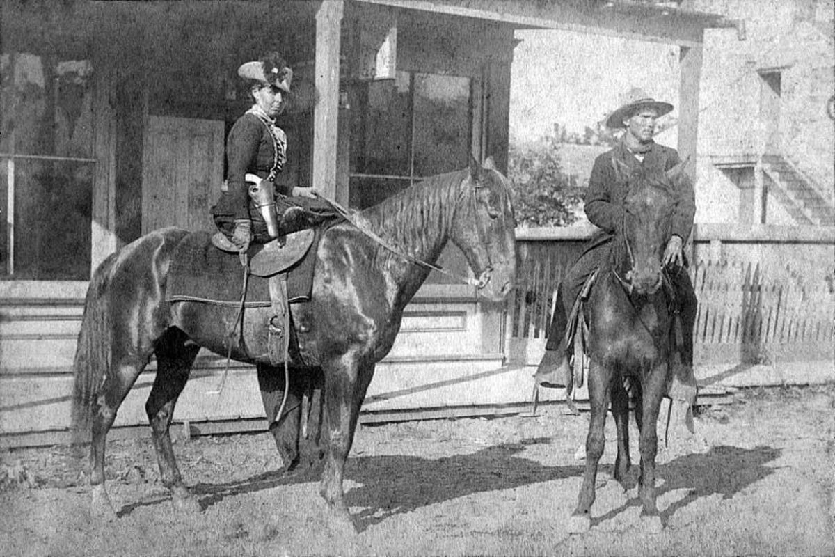Belle Starr, pearl-handled revolver prominently displayed.