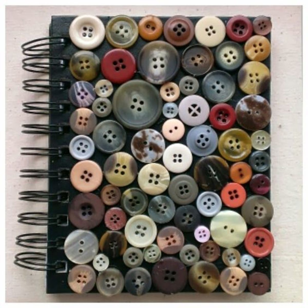 Just some strong tacky glue and some buttons laid out carefully makes this journal cover shine