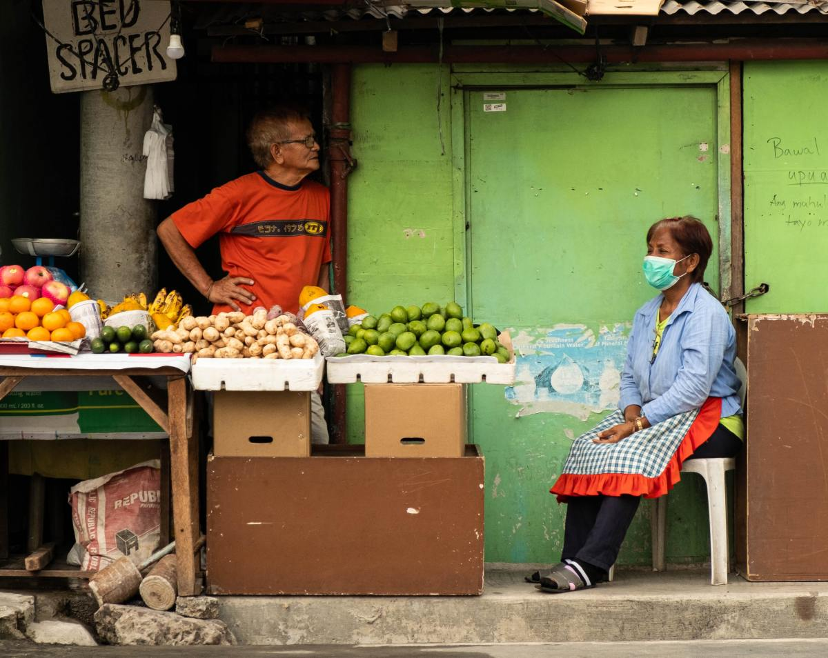 Can you describe the shopkeepers in this photo?