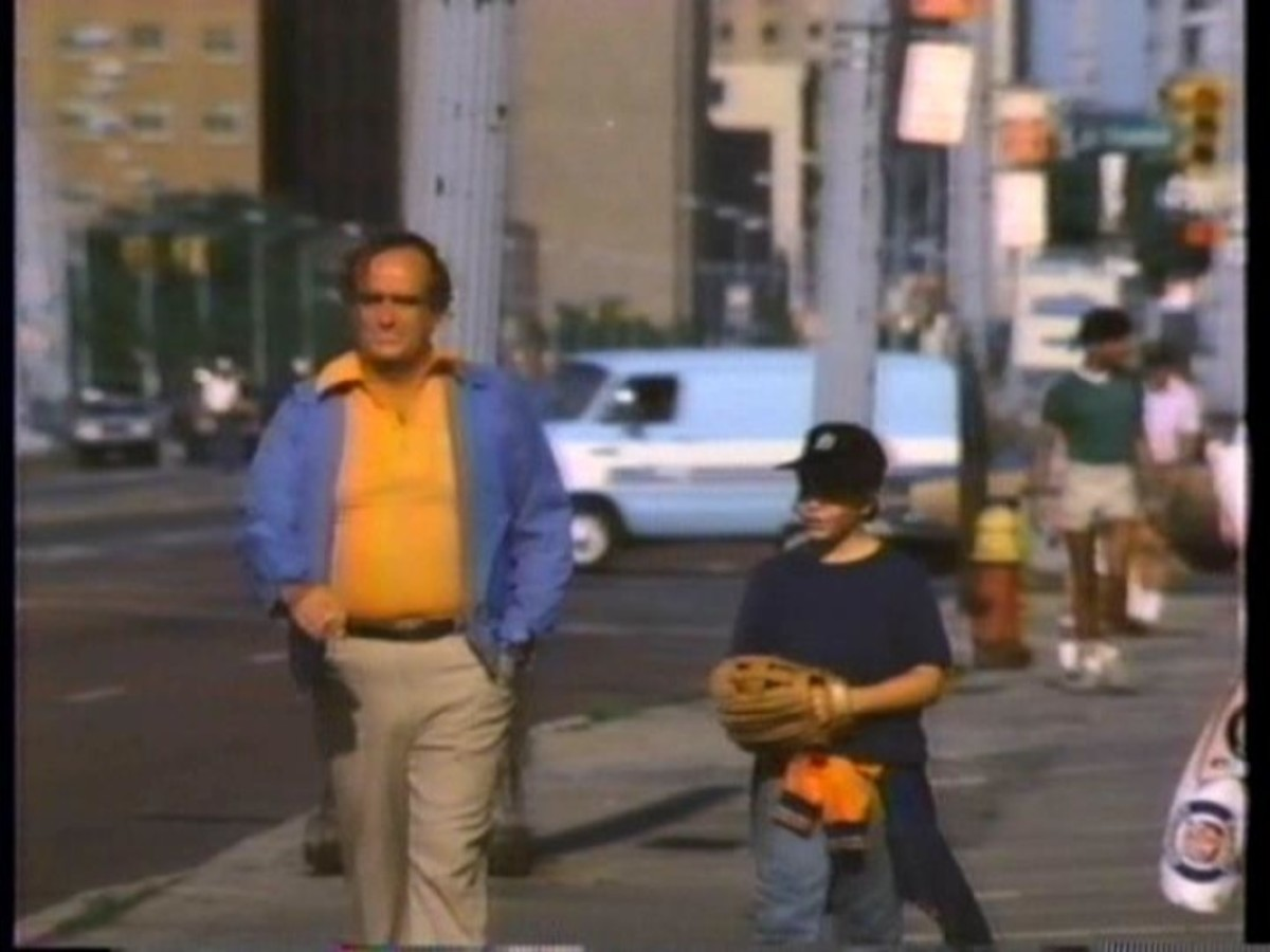 Buddy (Ron McLarty) and Alex walk down Michigan Avenue following another Tiger loss