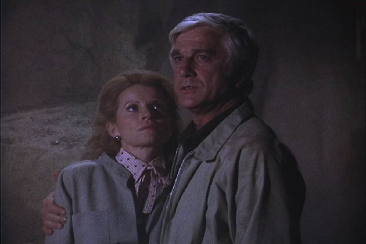 The Johnson's (Julie Sommars and Leslie Nielsen) support each other as they try to escape from a collapsed cave