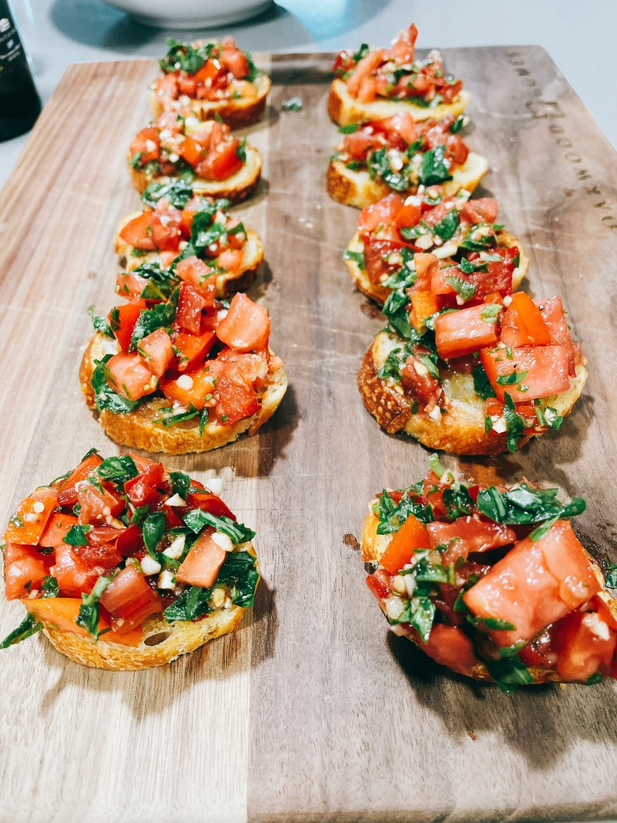 Homemade bruschetta with fresh ingredients from my father-in-law's garden. This bruschetta is perfect for an appetizer or snack. Oh, they are delicious!