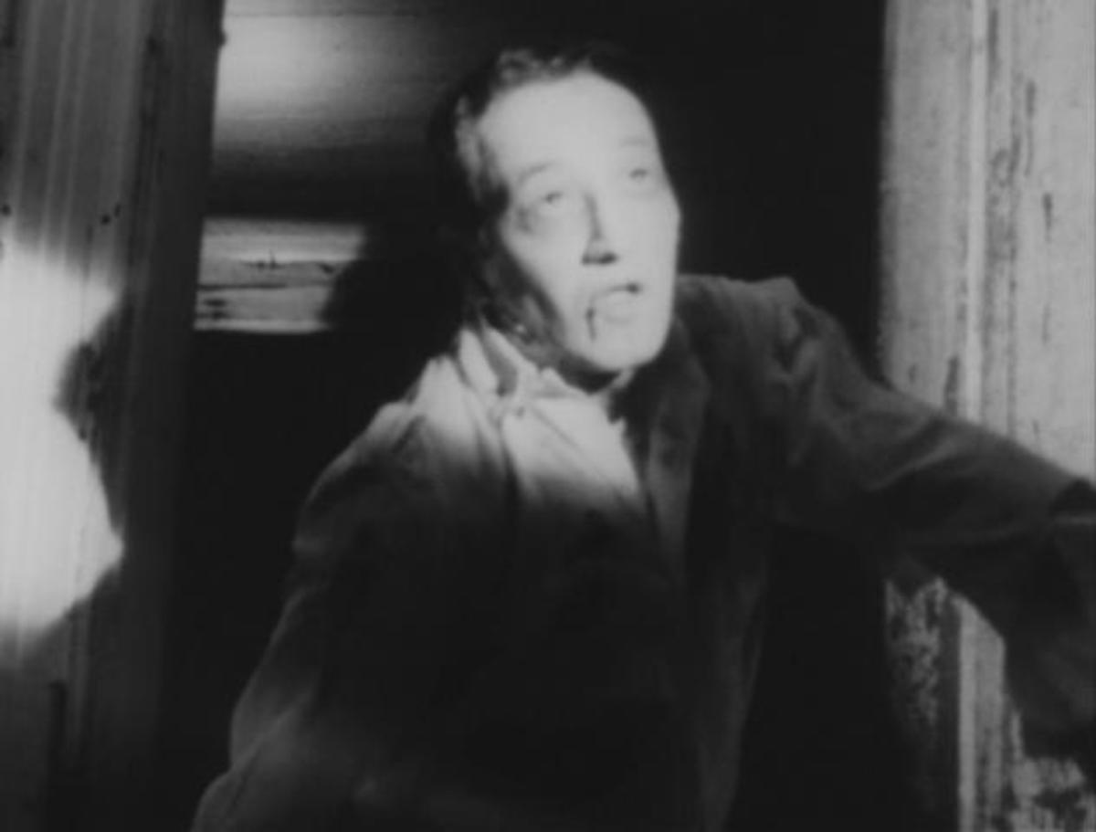 John A. Russo playing a Zombie in Night Of The Living Dead.