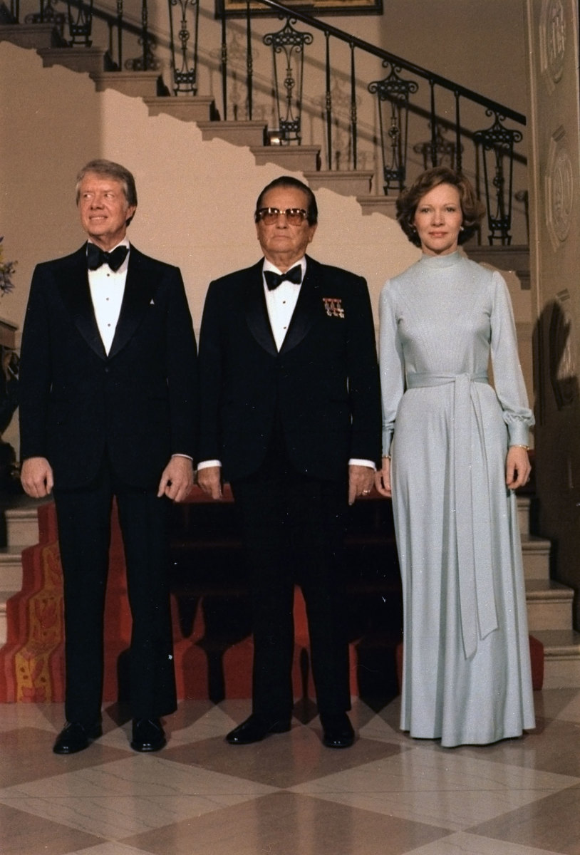 Jimmy Carter, Josip Tito and Rosalynn Carter pose for a formal portrait during a state dinner