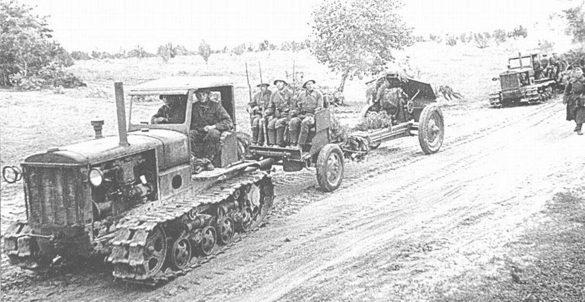 Soviet STZ-3 tractors towing 122 mm Howitzer M1938 (M-30) guns, Jun 1941