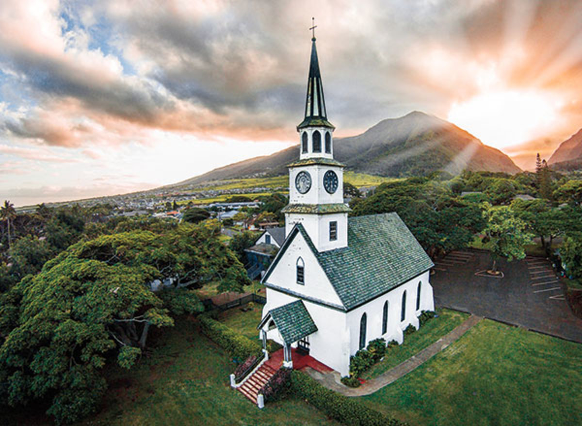 Drones can capture beautiful aerial views like this one of a church with a backdrop mountain view.