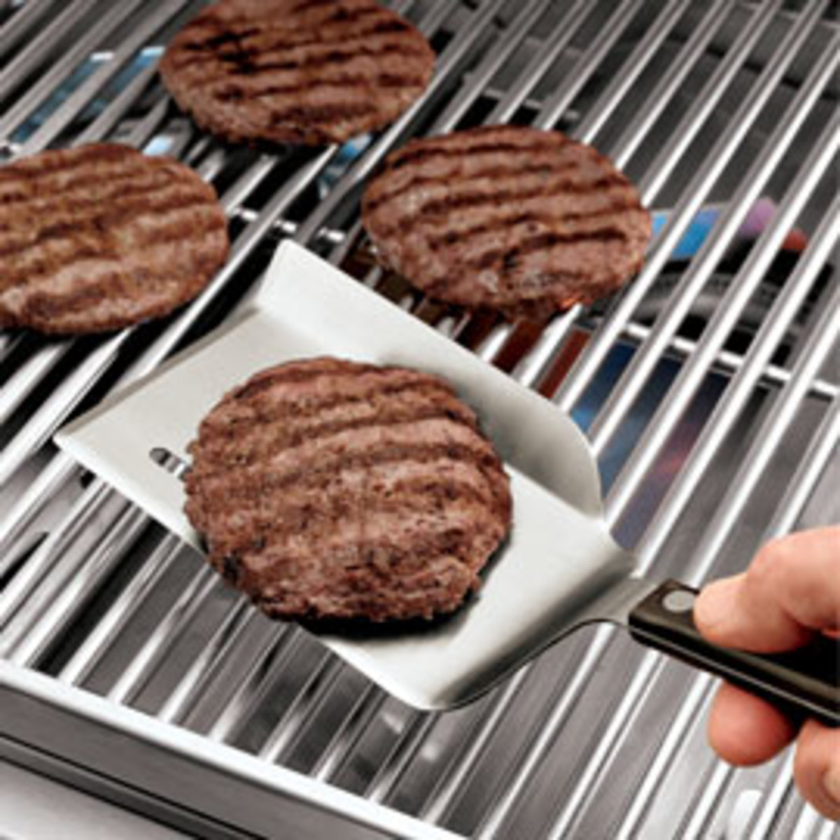 This BBQ Backstop Spatula keeps your grilled food from rolling away. This one runs about $10 at www.marinecorpsball.com