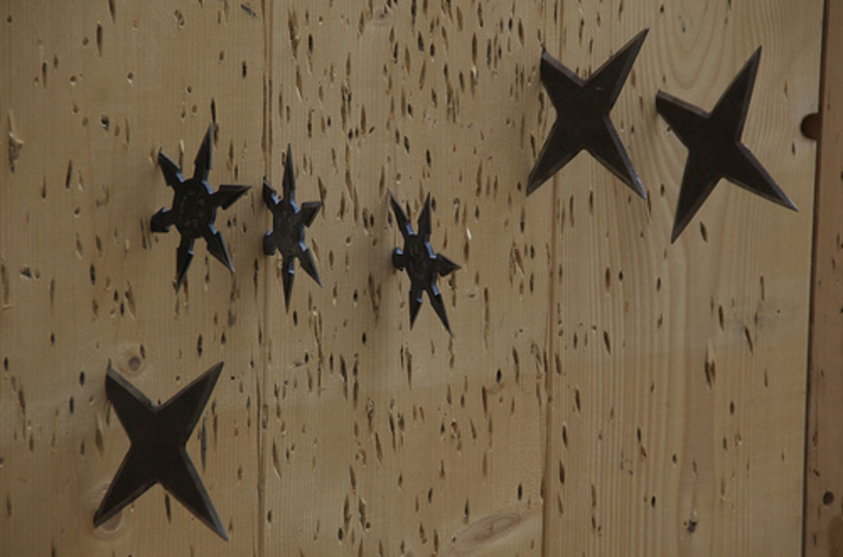 Shurikens stuck in wood