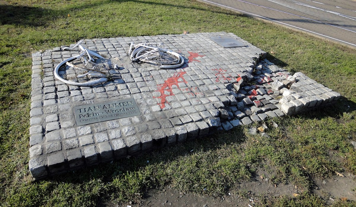 Monument in Memory of Chinese from Tiananmen in Poland, depicting a destroyed bike & tank track as a symbol of the Tiananmen Square protests. Officials destroyed the original monument the day after it was unveiled in 1989, but it was rebuilt in 1999.