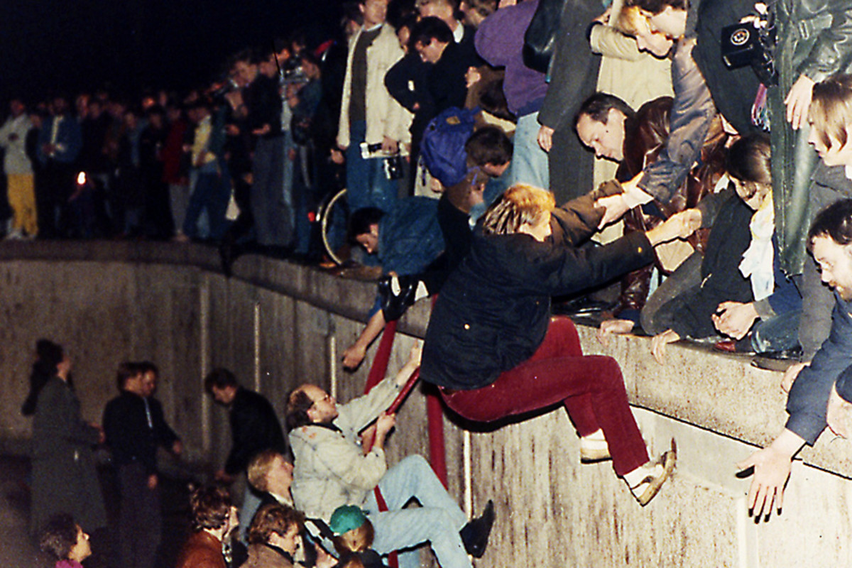 1989. Eventually Communist repression of Eastern Europe had to end. West Berliners help East Berliners escape over the Berlin Wall -symbol of the divide between freedom and dictatorship - on 10th November 1989