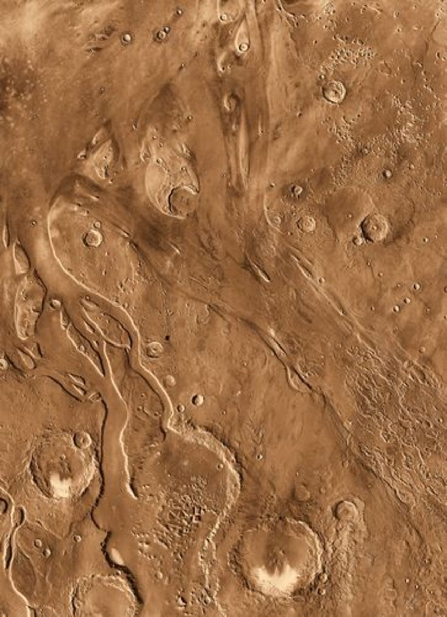 Further evidence of Mars's watery past. The relic of an ancient dried-up water flood plain can be seen amidst the Martian craters.