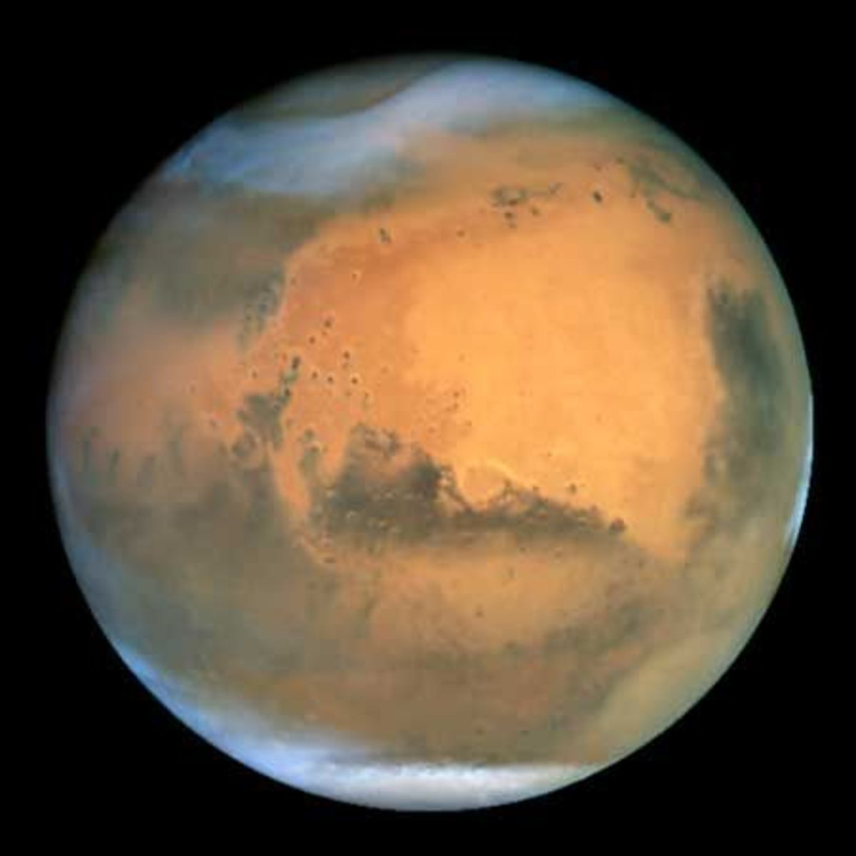The planet Mars. This photograph was taken by the Hubble Space Telescope