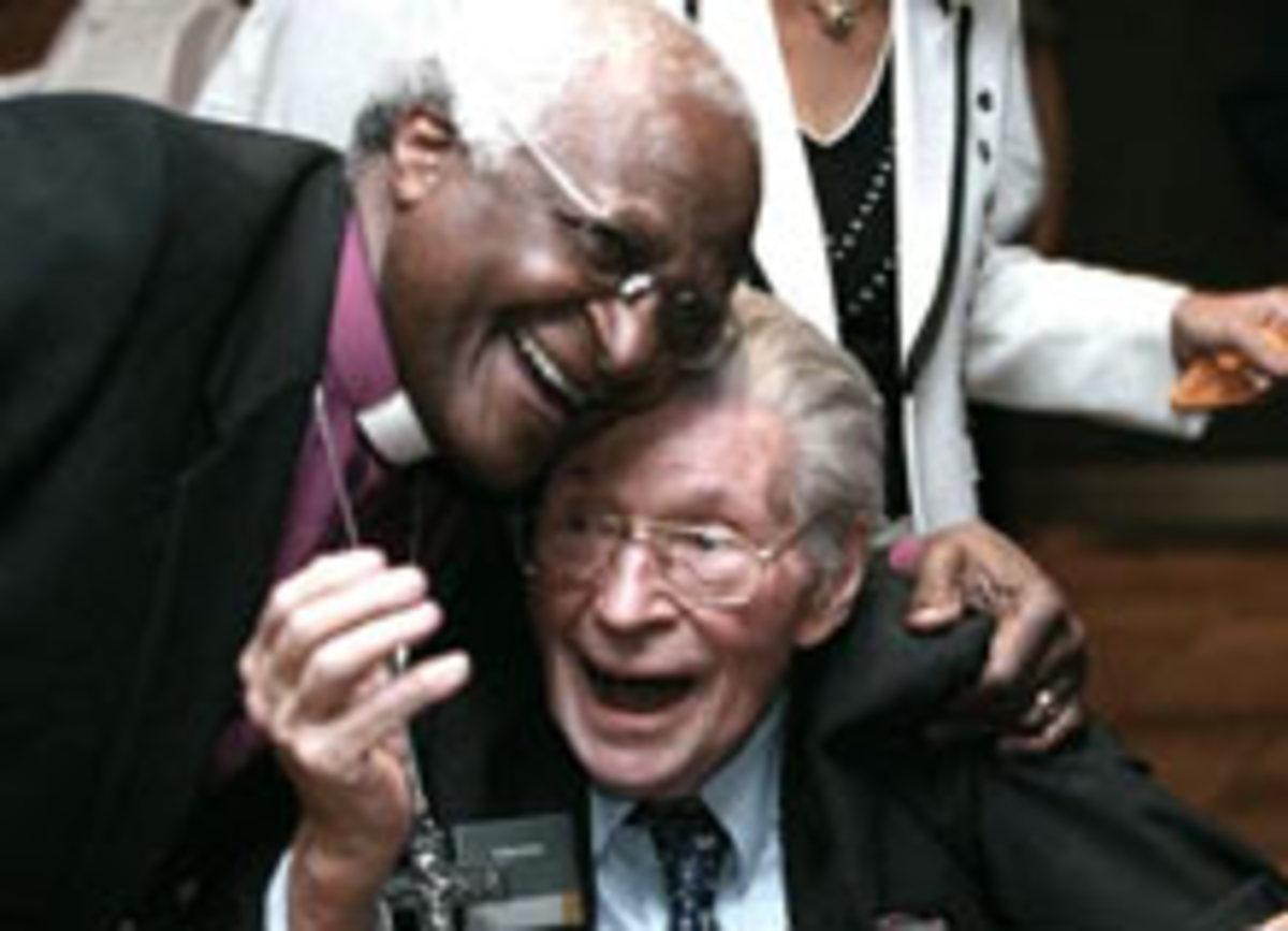 Desmond Tutu and Beyers Naud share a joke.