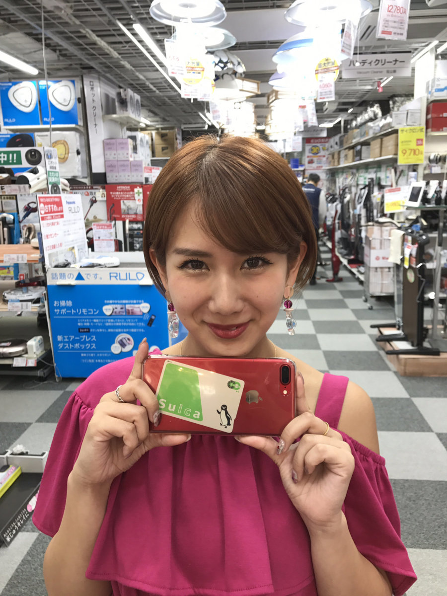 Chisato Okai one of the cutest members of the group was born in 1994. It looks like she is about to take a photo.