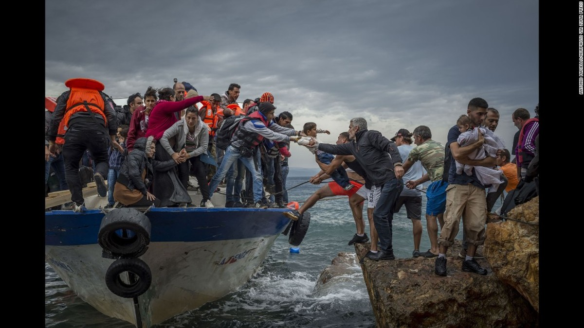 Refugees use all sorts of opportunities to go where they think is safe fore them. this group of refugees have embarked on a boat and reached what seems an island in the Mediterranean   Sea