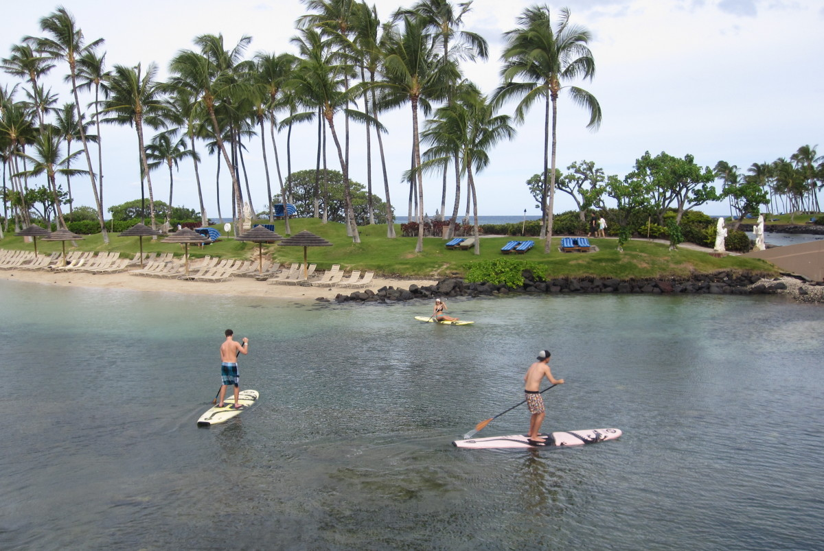 Paddle boarding on the lagoon at The Hilton Waikoloa Village.
