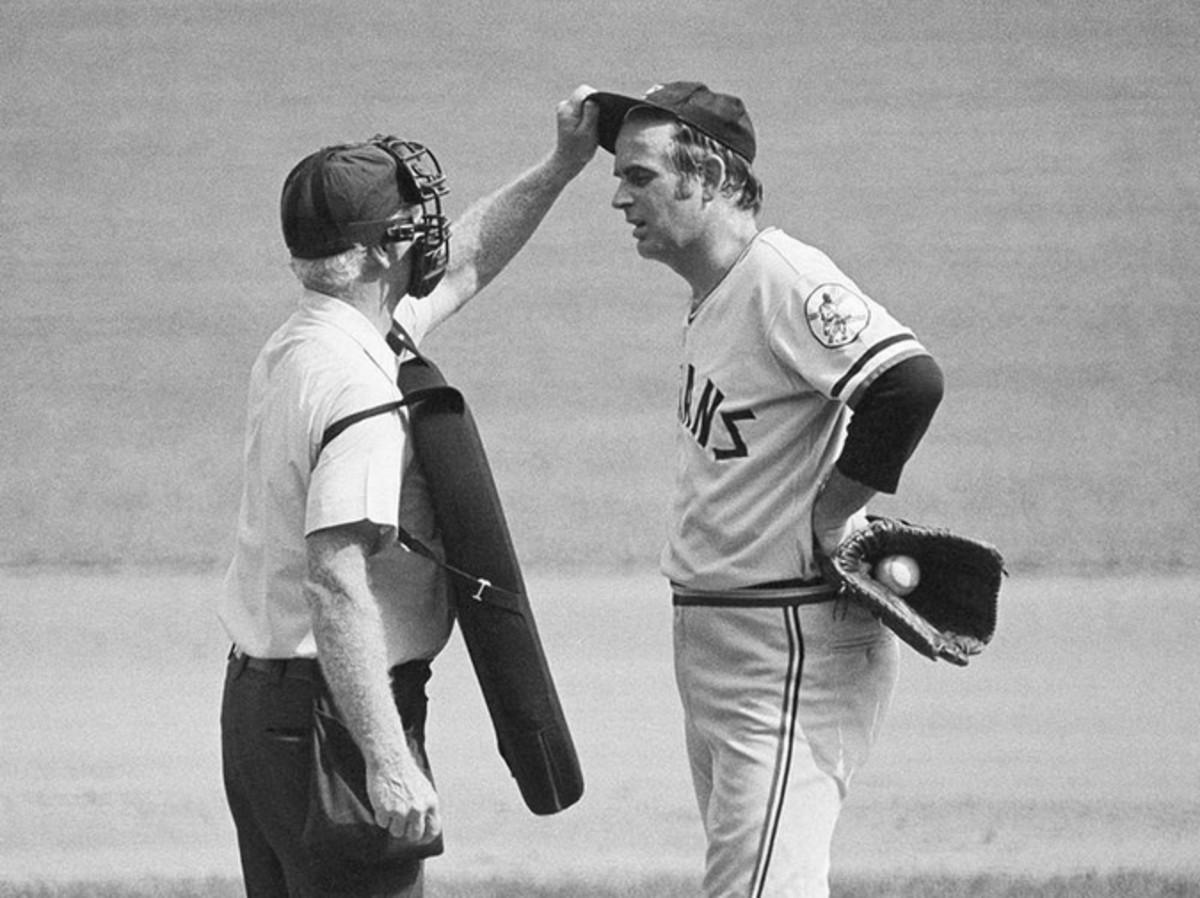 Home plate umpire checks Gaylord Perry for foreign substances