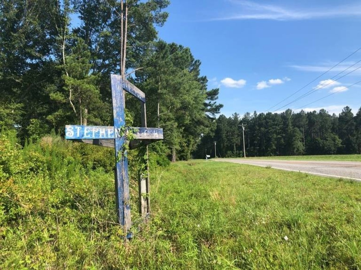 A cross marks the location where Stephen Smith was found along the quiet country road leading to his house. Photo courtesy of The Island Packet.